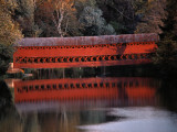 Morning Light Reflects a Red Covered Bridge in River Fotografisk trykk av Stephen St. John