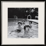 Paul McCartney, George Harrison, John Lennon and Ringo Starr Taking a Dip in a Swimming Pool Framed Photographic Print by John Loengard