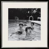 Paul McCartney, George Harrison, John Lennon and Ringo Starr Taking a Dip in a Swimming Pool Framed Photographic Print by John Loengard