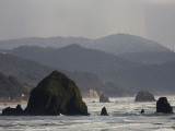The Rocky and Steep Oregon Coast on a Cloudy Afternoon Photographic Print by Michael Hanson