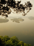 Foggy Sunrise over Dale Hollow Lake Photographic Print by Raymond Gehman
