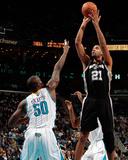 San Antonio Spurs v New Orleans Hornets: Tim Duncan and Emeka Okafor Photo by Chris Graythen