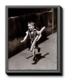 Petit Parisien Framed Canvas Print by Willy Ronis