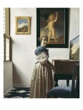 A Young Woman Standing at a Virginal Pósters por Johannes Vermeer