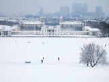 Maritime Museum, Royal Naval College and Canary Wharf Covered in Snow, from Greenwich Park Photographic Print by Doug McKinlay