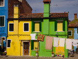 Colorful Houses and Laundry Photographic Print by Dennis Walton