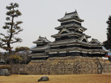 Matsumoto Castle with Moat and Stone Work Photographic Print by Frank Carter