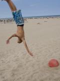 Boys Jumping at Las Arenas Beach Photographic Print by Krzysztof Dydynski