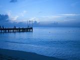 Tourists Watching Sunset from Occidental Grand Cozumel Resort Pier Fotografisk trykk av Dennis Johnson