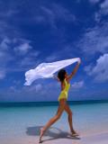 Woman Running on Beach with White Sarong Overhead Fotografisk trykk av Greg Johnston