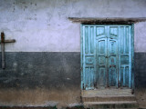 Blue Door and Cross on Wall Photographic Print by Douglas Steakley
