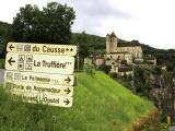 Tourist Signs Outside Village of St. Cirq Lapopie Fotografie-Druck von Barbara Van Zanten