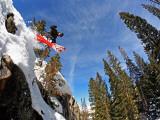 Skier Jumping Off Small Cliff at Brighton Ski Resort Fotografie-Druck von Paul Kennedy