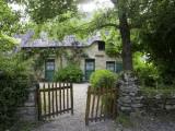 Thatched Cottage with Green Doors in Restored Village of Kerhinet, Briere National Park Fotografie-Druck von Barbara Van Zanten