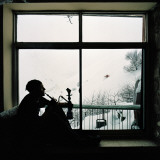 Man Smoking Water Pipe by Window, Alborz Mountain Range Reproduction photographique par Christian Aslund