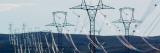 High Voltage Power Lines Spanning Rolling Hills Seinätarra