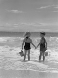 Boy and Girl Standing on Beach, Holding Hands, Rear View Photographic Print by H. Armstrong Roberts