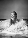 Young Woman Lying in Surf, Laughing Fotografisk tryk af H. Armstrong Roberts