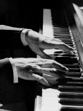 Man's Hands Playing Piano in Dim Lighting Photographic Print by H. Armstrong Roberts