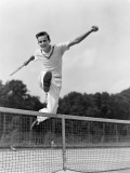 Teen in Tennis Whites Hurdleing the Net With Arms Fotografisk tryk af H. Armstrong Roberts