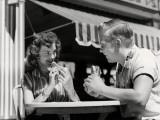 Couple Eating Hot Dogs Photographic Print by H. Armstrong Roberts