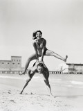 Couple Playing Leapfrog on Beach, Woman Jumping Over Man Photographic Print by H. Armstrong Roberts