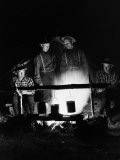 Four Men Wearing Plaid Shirts, Suspenders and Hats, Cooking Over Campfire Reproduction photographique par H. Armstrong Roberts