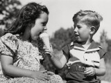 Boy Letting Girl Lick His Ice-Cream Cone Fotografisk trykk av H. Armstrong Roberts