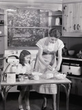 Mother and Daughter at Kitchen Table, Preparing Ingredients in Mixer For Baking Fotografisk tryk af H. Armstrong Roberts