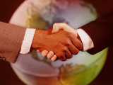 Handshake in Front of Globe Photographic Print by H. Armstrong Roberts