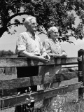 Elderly Couple on Farm Standing at Wooden Fence Looking Off Into Distance Fotografisk tryk af H. Armstrong Roberts