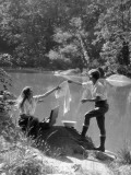 Two Women Camping By Lake Washing Clothes Fotografisk tryk af H. Armstrong Roberts