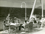 People Having Drinks on Deck of Cruise Ship Photographic Print by George Marks