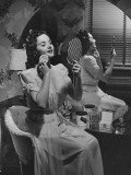 Woman Applying Make Up at Vanity Table Photographic Print by George Marks