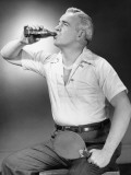 Mature Man Holding Table Tennis Bat, Drinking Cola From Bottle Photographic Print by George Marks