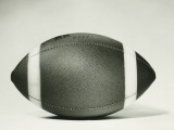 Rugby Ball Against White Background, Close-Up Photographic Print by George Marks