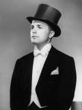 Man Wearing Tuxedo and Top Hat Posing in Studio Photographic Print by George Marks