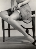 Close-Up of Legs With Garters Being Attached Impressão fotográfica por George Marks