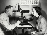Eye Doctor Examining Patient Photographic Print by George Marks