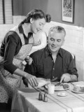 Housewife Serving Dinner To Husband Reproduction photographique par George Marks