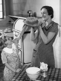 Mother and Daughter Baking Cake Photographic Print by George Marks