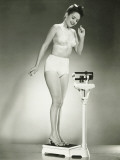 Woman in Underwear Standing on Scale Reproduction photographique par George Marks
