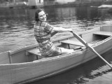 Woman Rowing Boat on Lake Photographic Print by George Marks