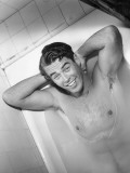 Naked Man Lying in Bathtub Reproduction photographique par George Marks
