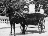 Girls Travelling in Horse Drawn Carriage Photographic Print
