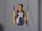 Male Gymnast Performing on the Rings Impressão fotográfica