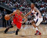 Chicago Bulls v Atlanta Hawks - Game Four, Atlanta, GA - MAY 08: Jeff Teague and Derrick Rose Photo by Kevin Cox