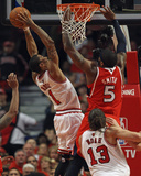 Atlanta Hawks v Chicago Bulls - Game Five, Chicago, IL - MAY 10: Derrick Rose and Josh Smith Photo by Jonathan Daniel