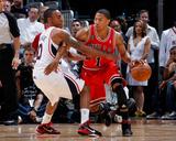 Chicago Bulls v Atlanta Hawks - Game Three, Atlanta, GA - MAY 6: Jeff Teague and Derrick Rose Photo by Kevin Cox