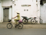 Woman Riding Bicycle Along Street, Ben Tre, Vietnam Photographic Print by Ian Trower